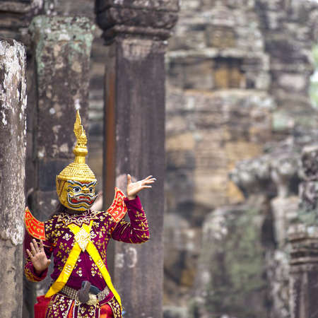 legend: Hindu cultural legend of deity with hands gestures reenacting by an actor in colorful costume at Bayon temple ruins, Angkor Wat, Siem Reap