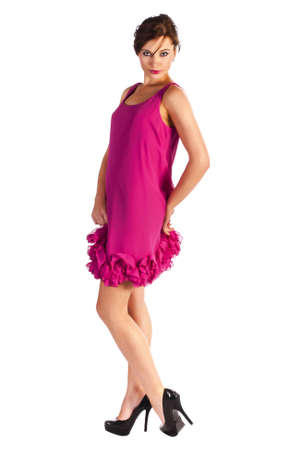 pink posing: Young and sexy woman model in pink dress and black shoes with heels posing Stock Photo