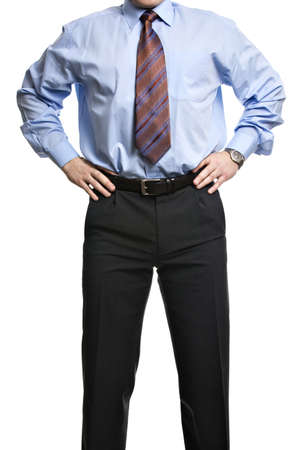 Unrecognizable businessman in blue shirt stands with hands on the waist Stock Photo