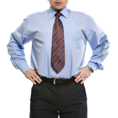 hands on waist: Unrecognizable businessman in blue shirt stands with hands on the waist Stock Photo