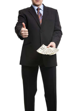 show bill: Some unrecognizable Businessman in suit showing  a Spread of Cash and thumb up, Isolated on white background. Man with dollars symbolizing Success, Motivation, Wealth. Foto de archivo