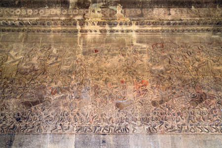 number 12: Ancient Khmer bas-relief showing Hindu legend scenes at Angkor Wat temple, Cambodia. Part of  series of the wall. Image number 12