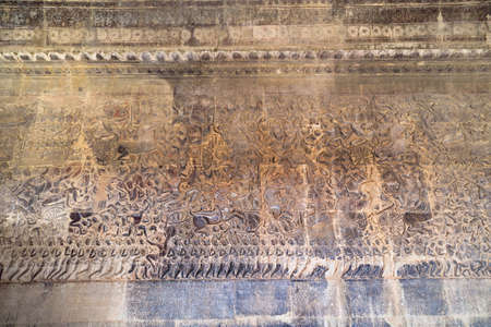 number 15: Ancient Khmer bas-relief showing Hindu legend scenes at Angkor Wat temple, Cambodia. Part of  series of the wall. Image number 15