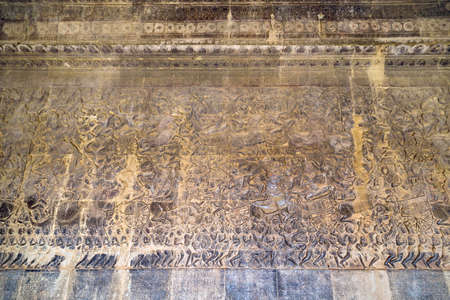 number 14: Ancient Khmer bas-relief showing Hindu legend scenes at Angkor Wat temple, Cambodia. Part of  series of the wall. Image number 14 Stock Photo