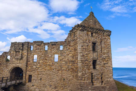 fife: St Andrews Castle ruins on blue sky background, Fife, Scotland.