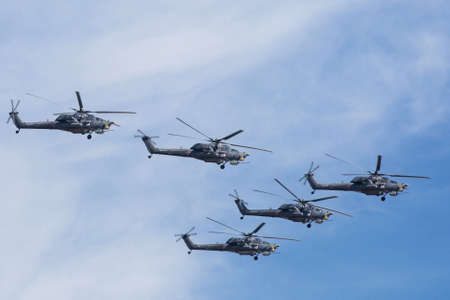 may fly: MOSCOW, RUSSIA - MAY 9: Mi-28N (Havoc) attack helicopters of aerobatic team Berkuty fly on military parade devoted to 70th anniversary of Victory Day in WWII in Europe aka The Great Patriotic War.