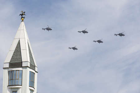 may fly: MOSCOW, RUSSIA - MAY 9: Ansat-U light multipurpose helicopters fly on military parade devoted to 70th anniversary of Victory Day in WWII in Europe aka The Great Patriotic War.