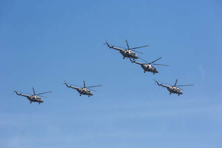 may fly: MOSCOW, RUSSIA - MAY 9: Mi-26 (Halo) helicopters fly on military parade devoted to 70th anniversary of Victory Day in WWII in Europe aka The Great Patriotic War.