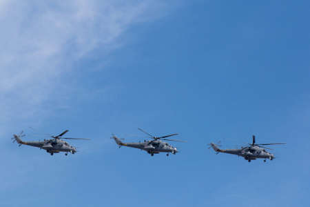 may fly: MOSCOW, RUSSIA - MAY 9: MI-24 attack helicopters fly on military parade devoted to 70th anniversary of Victory Day in WWII in Europe aka The Great Patriotic War.