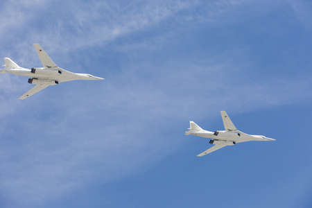 supersonic: MOSCOW, RUSSIA - MAY 9, 2015: Supersonic strategic bombers Tu-160 (White Swan) at military parade devoted to 70th anniversary of Victory Day in WWII in Europe aka The Great Patriotic War.