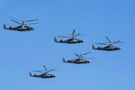 may fly: MOSCOW, RUSSIA - MAY 9: Kamov Ka-52 (Alligator) attack helicopters of aerobatic team Berkuty fly on military parade devoted to 70th anniversary of Victory Day in WWII in Europe aka The Great Patriotic War.