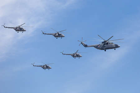 may fly: MOSCOW, RUSSIA - MAY 9: Mi-26 (Halo) and Mi-8AMTK (Hip) helicopters fly on military parade devoted to 70th anniversary of Victory Day in WWII in Europe aka The Great Patriotic War.