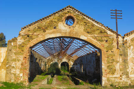Ruins of abandoned loading bays for trucks and railway at Sao Domingos  mine in Alentejo, Portugal. Stock Photo