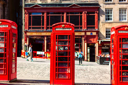 Retro old red telephone booths on Royal mile street in Edinburgh, Capital of Scotland, United Kingdom.