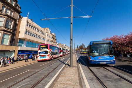 Edinburgh, Scotland, UK - April 18 2014: Public transport, i.e. buses, taxis and trams on Princes Street in Edinburgh.