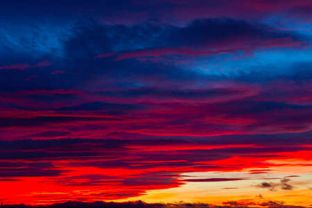 Picturesque dramatic colorful vibrant sunset sky with clouds.