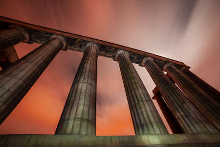 The National Monument on Carlton Hill in Edinburgh, Scotland. Ancient Parthenon like colonade monument. Night scene. Long exposure.