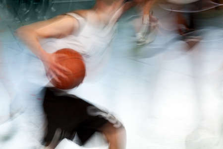 hand movements: a sportsman in a basketball game with a basketball