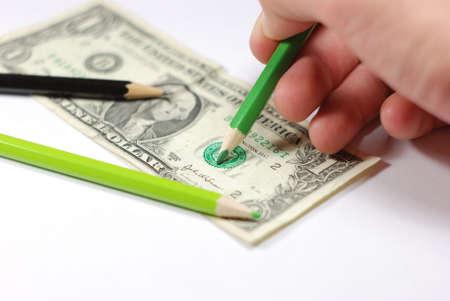 Man drawing a counterfeit bill. photo