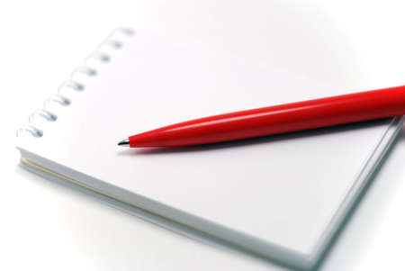 bearer: notebook and a red pen, close-up Stock Photo