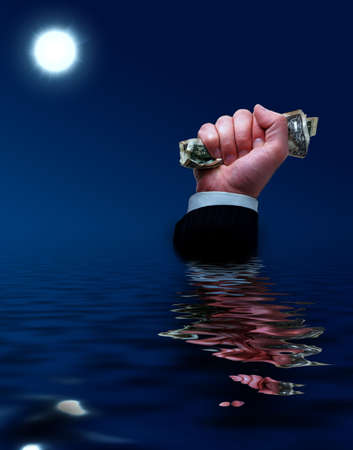 Businessman sinks with cash in his hands photo