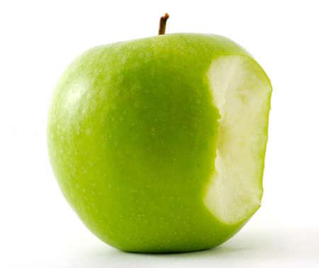 The bitten off green apple