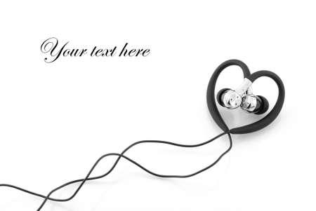 heart-shaped earphones isolated on white photo