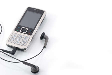 Mobile phone with earphones. Mobile music. Isolated on a white background photo
