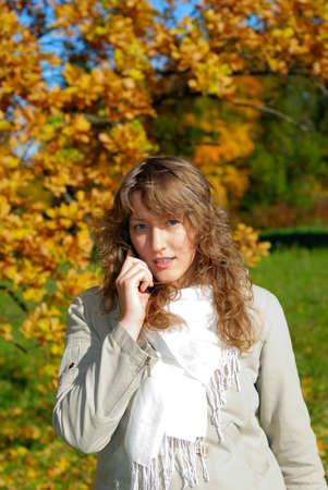 young fresh woman calling by phone in autumn Stock Photo - 4128239