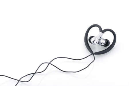 heart-shaped earphones isolated on white photo
