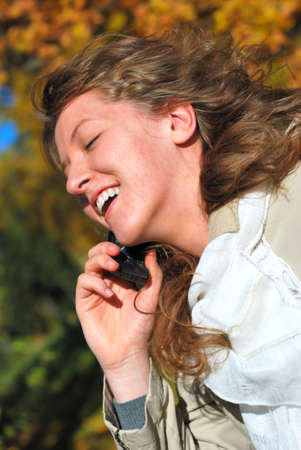 young fresh woman calling by phone in autumn Stock Photo - 4128238