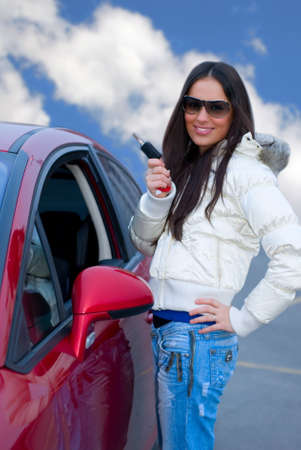 young woman and her keys to auto photo
