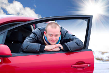 automobile door: young man and his new car Stock Photo