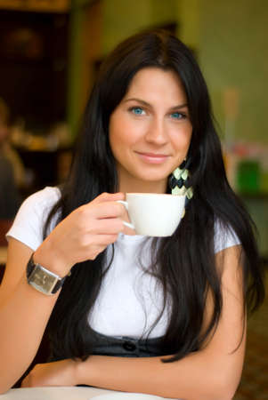 beautiful woman in cafe photo