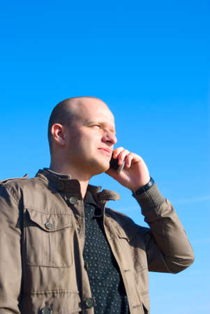 man speaking on a mobile photo