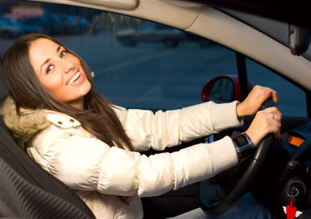 young woman in her car photo