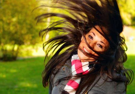 woman shakes her hairn photo
