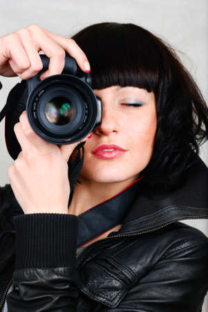 woman with photocamera photo