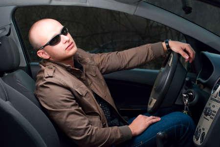 window shades: driver in sunglasses