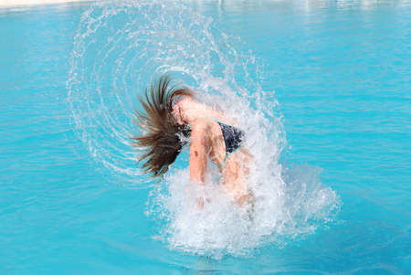 jumping out of pool Stock Photo - 6443709