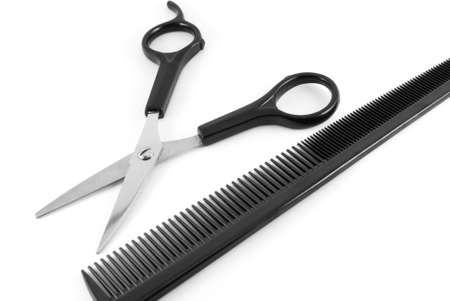 comb:  scissors and comb isolated on white