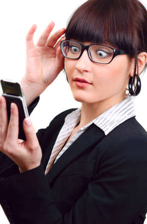 shocked businesswoman holding mobile phone isolated on white photo