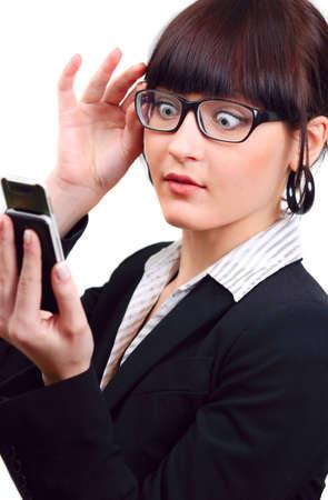 shocked businesswoman holding mobile phone isolated on white photo