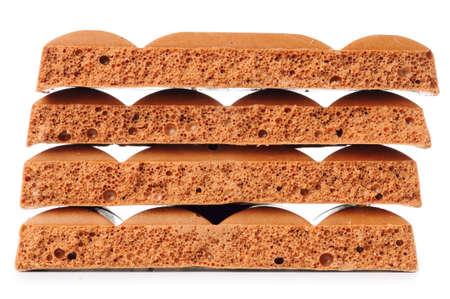 porous chocolate bars isolated on white photo