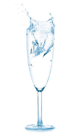 splash in water glass isolated on white photo