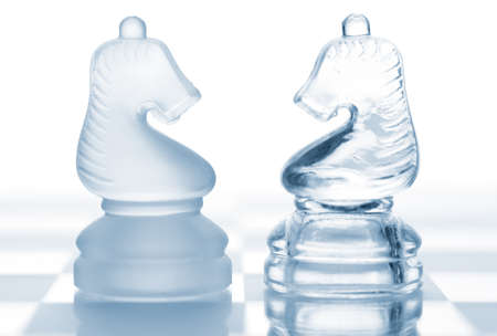 Chess knights. The concept of confrontation  photo