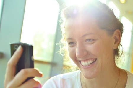 woman is watching at phone Stock Photo