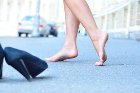 female bare feet dancing on summer street Stock Photo - 8105995