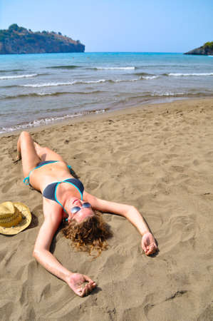 sexy woman is lying on the beach and, top view photo