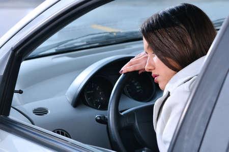 beautiful woman is sleeping in a car photo